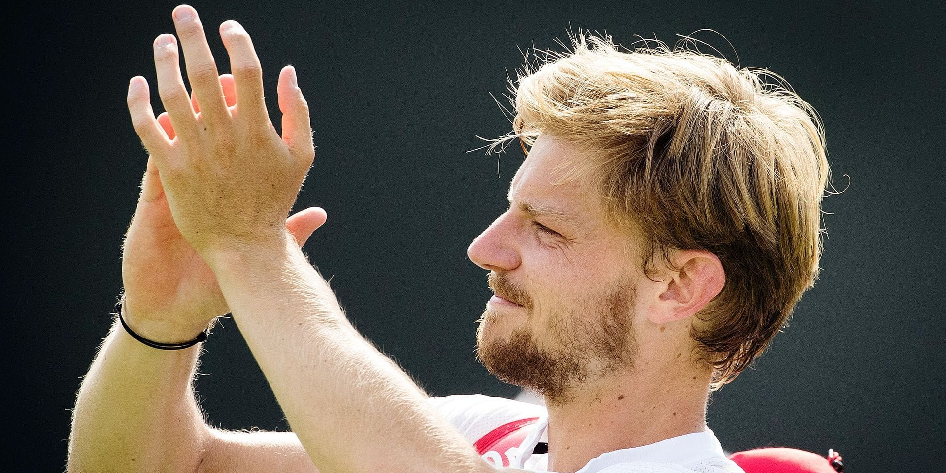 Belgian David Goffin celebrates after winning a tennis match between Belgian David Goffin (ATP23) and Spanish Fernando Verdasco (ATP37) in the men's singles fourth round at the 2019 Wimbledon grand slam tennis tournament at the All England Tennis Club, in south-west London, Britain, Monday 08 July 2019. BELGA PHOTO BENOIT DOPPAGNE