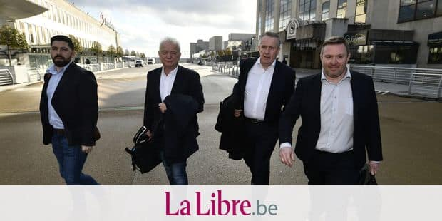 Ryanair HR director Eddie Wilson (center L) and Ryanair COO Peter Bellew (center R) leave after a meeting between a delegation of Irish low-cost airline Ryanair and the CNE-LBC trade union, near Brussels Airport, in Zaventem, Friday 19 January 2018. For the first time, Ryanair has agreed to meet the Christian trade unions LBC-CNE. BELGA PHOTO ERIC LALMAND