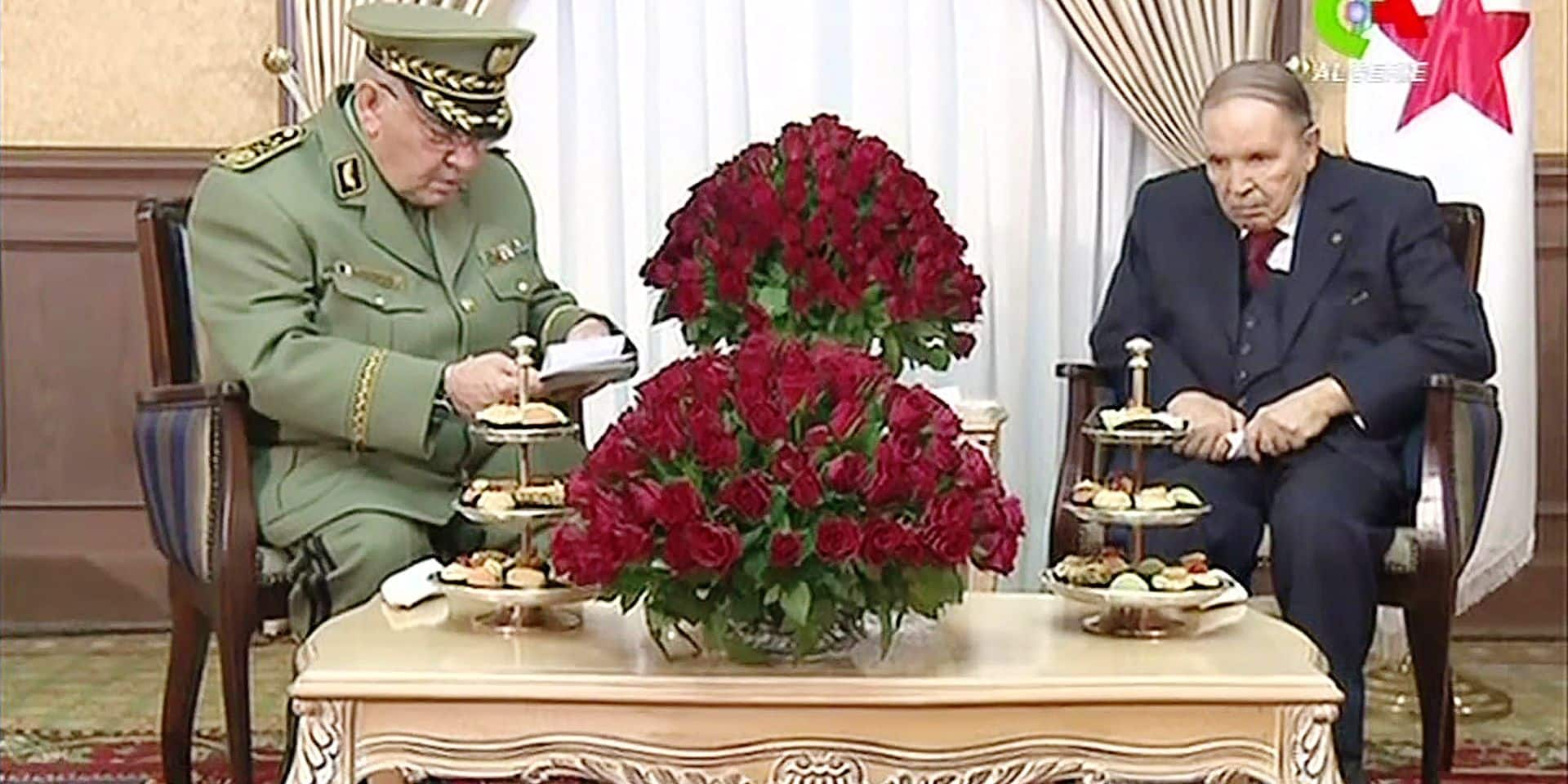 """(FILES) In this file video grab taken from footage broadcast by Algeria's """"Canal Algerie"""" on March 11, 2019, Algerian President Abdelaziz Bouteflika (R) meets with Algeria's army chief, Ahmed Gaid Salah in the capital Algiers. - Algeria army chief Salah called on March 26, 2019 for Bouteflika to be declared unfit to rule. Bouteflika said on February 22 he would run for a fifth term in April 18 elections, despite concerns about his ability to rule. The 82-year-old uses a wheelchair and has rarely appeared in public since suffering a stroke in 2013. His current mandate expires on April 28. (Photo by - / CANAL ALGERIE / AFP) / BEST QUALITY AVAILABLE / XGTY / == RESTRICTED TO EDITORIAL USE - MANDATORY CREDIT """"AFP PHOTO / HO / CANAL ALGERIE"""" - NO MARKETING NO ADVERTISING CAMPAIGNS - DISTRIBUTED AS A SERVICE TO CLIENTS =="""