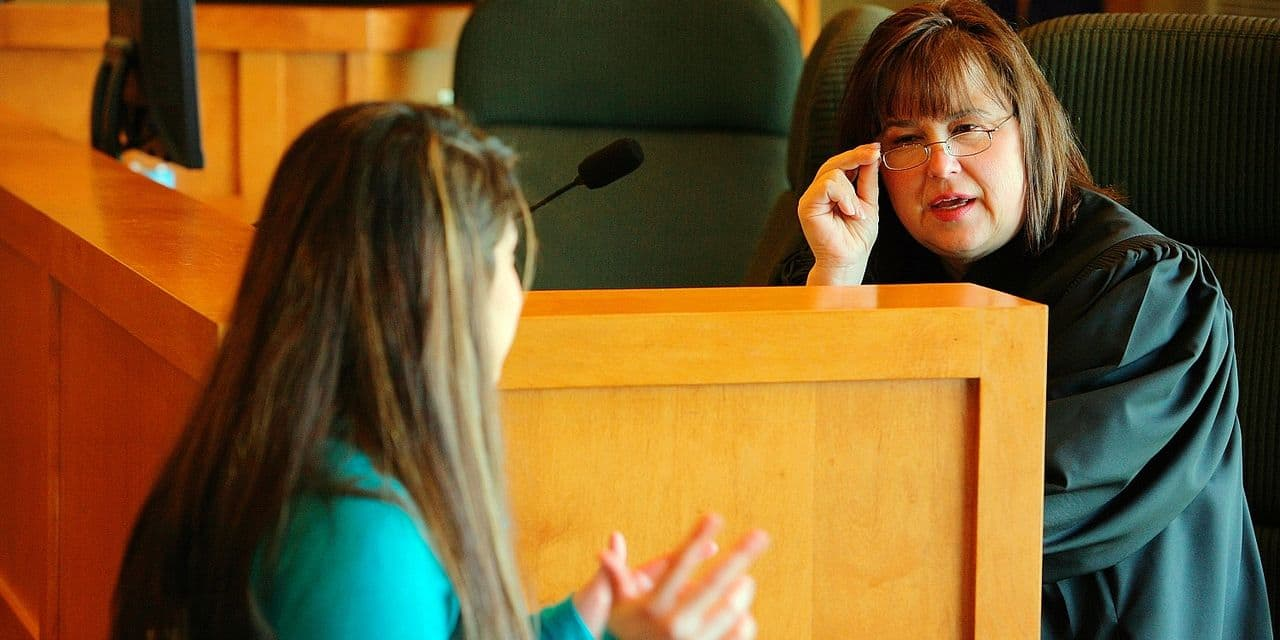 A Teenage Girl Talking To A Judge Reporters / Design Pix