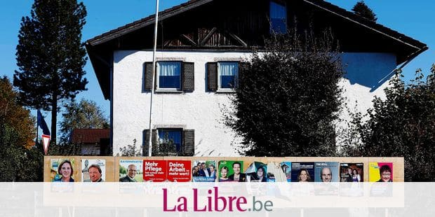 In this Oct. 10, 2018 photo election posters stand in the small village Hundham near Rosenheim, Germany. This weekend's state election in Bavaria has been casting a long shadow over German politics for the past year, and the aftershocks could cause more turbulence for Chancellor Angela Merkel's struggling national government. Polls suggest that Bavaria's center-right Christian Social Union party, which has run the southeastern region for 61 years, is heading for its worst performance since the 1950s on Sunday. (AP Photo/Matthias Schrader)