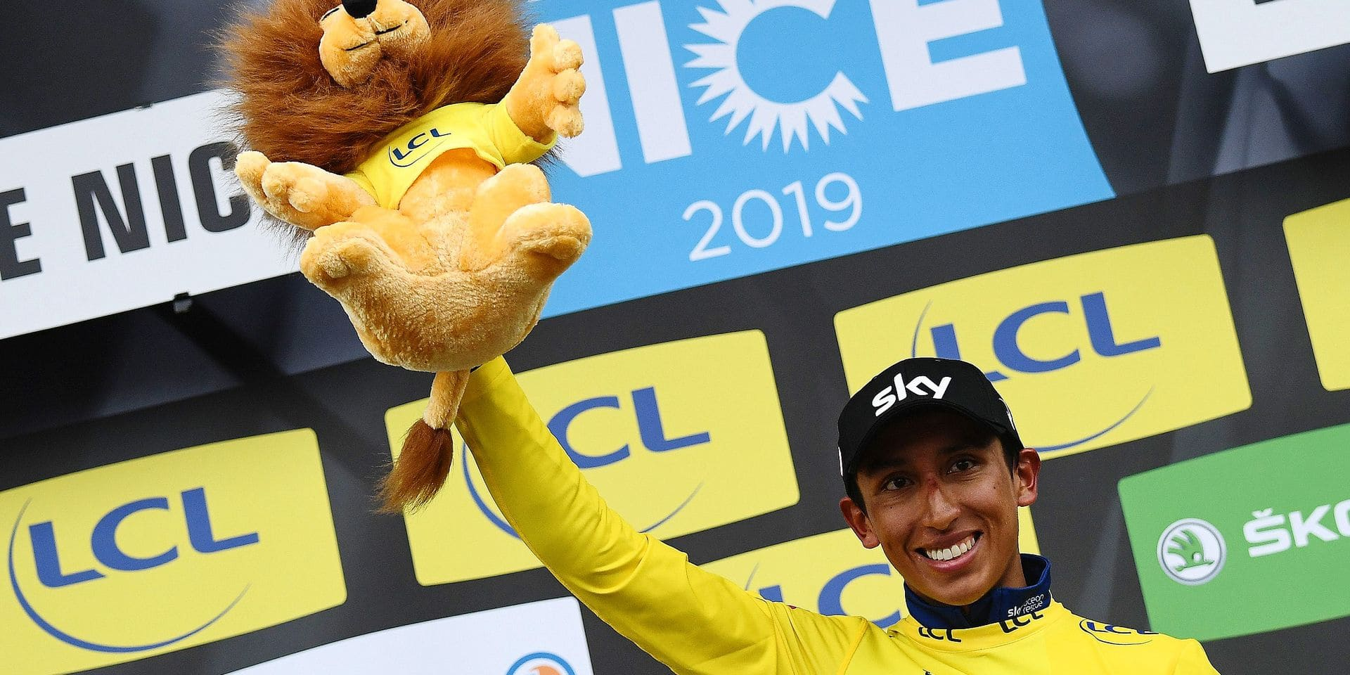 Colombia's Egan Bernal celebrates his overall leader yellow jersey on the podium at the end of the 110km 8th and last stage of the 77th Paris-Nice cycling race stage between Nice and Nice on March 17, 2019. (Photo by Anne-Christine POUJOULAT / AFP)