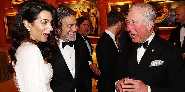 12 March 2019. LONDON, ENGLAND - MARCH 12: Amal Clooney and George Clooney speak to Prince Charles, Prince of Wales as they attend a dinner to celebrate The Prince's Trust, hosted by Prince Charles, Prince of Wales at Buckingham Palace on March 12, 2019 in London, England. The Prince of Wales, President, The Princes Trust Group hosted a dinner for donors, supporters and ambassadors of Princes Trust International. Credit: Ken Goff Rota/GoffPhotos.com Ref: KGC-375 **No UK Sales Until 28 Days After Create Date** Reporters / Goff