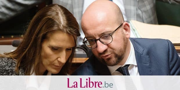 Minister of Budget Sophie Wilmes and Belgian Prime Minister Charles Michel pictured during a plenary session of the chamber at the federal parliament in Brussels, with the debate on the political declaration that Belgian Prime Minister made yesterday, Monday 17 October 2016. The governmental declaration was initialy set on 11 October but there was no agreement on budget, and it was rescheduled on a Sunday, with the debate on Monday and the vote on Tuesday. BELGA PHOTO BENOIT DOPPAGNE