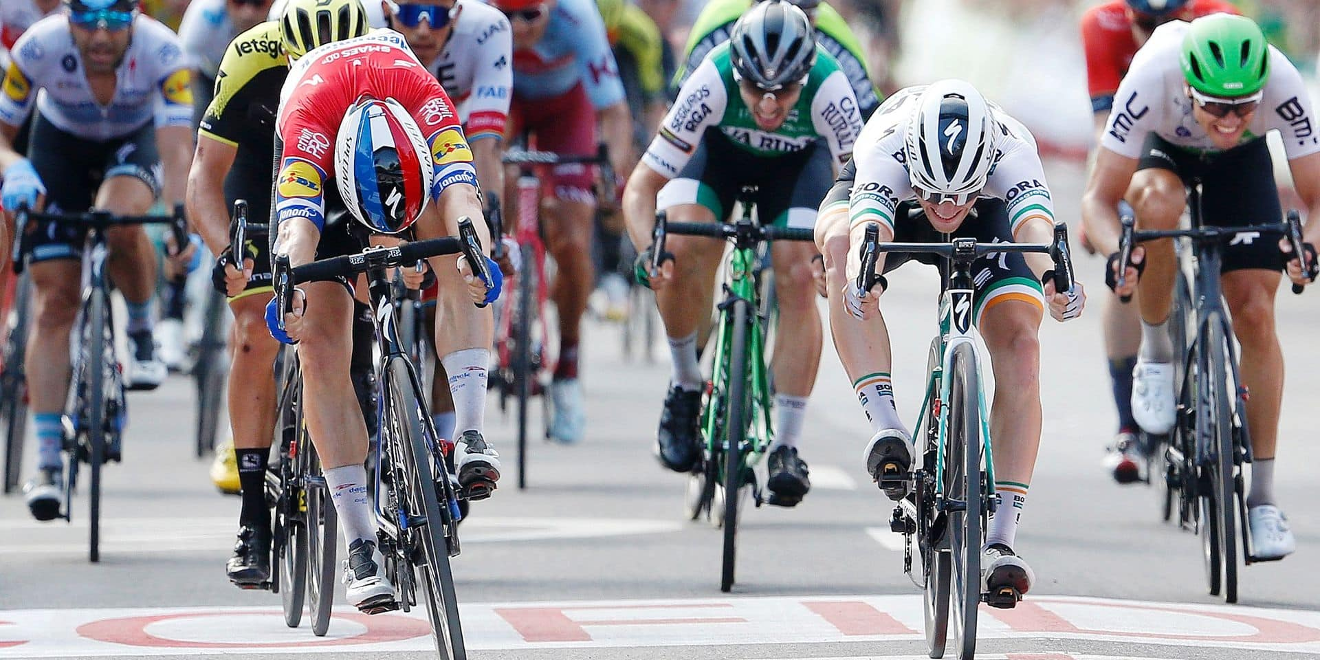 Dutch Fabio Jakobsen of Deceuninck - Quick-Step and Irish Sam Bennett of Bora-Hansgrohe finish ahead of the fourth stage of the 2019 edition of the 'Vuelta a Espana', Tour of Spain cycling race, 175,5km from Cullera to El Puig, Spain, Tuesday 27 August 2019. BELGA PHOTO YUZURU SUNADA