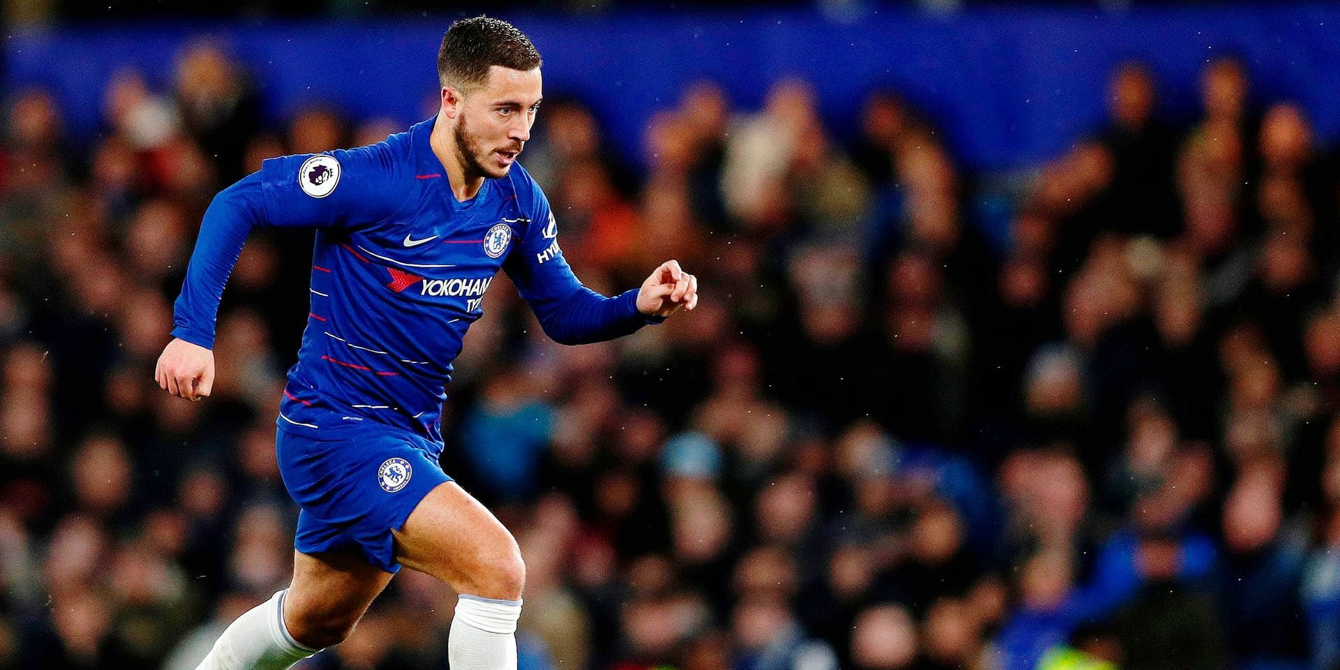 Chelsea's Belgian midfielder Eden Hazard runs with the ball during the English Premier League football match between Chelsea and Newcastle United at Stamford Bridge in London on January 12, 2019. (Photo by Adrian DENNIS / AFP) / RESTRICTED TO EDITORIAL USE. No use with unauthorized audio, video, data, fixture lists, club/league logos or 'live' services. Online in-match use limited to 120 images. An additional 40 images may be used in extra time. No video emulation. Social media in-match use limited to 120 images. An additional 40 images may be used in extra time. No use in betting publications, games or single club/league/player publications. /