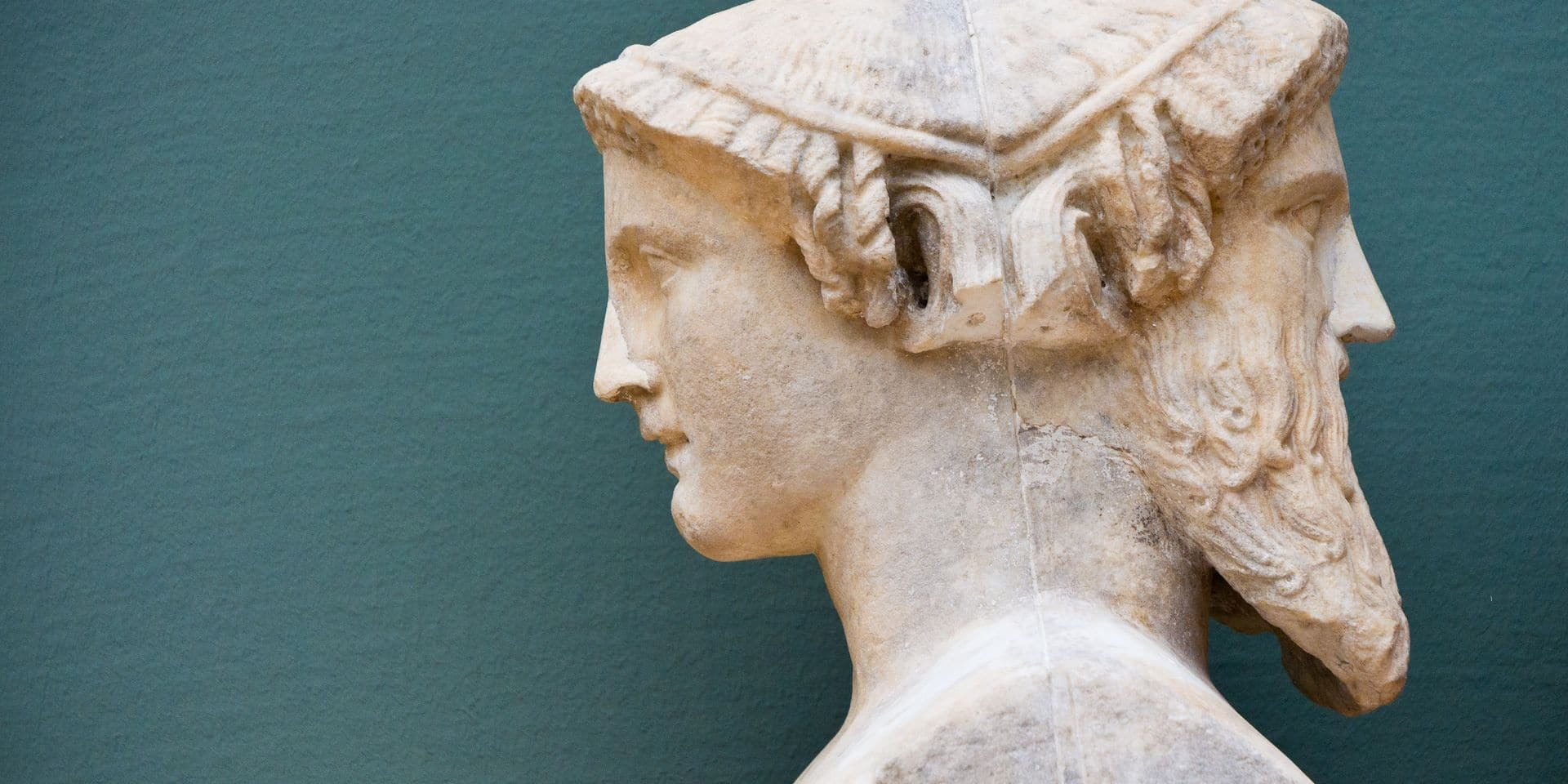 Two,Faces,Of,A,Person,-,Historical,Sculpture