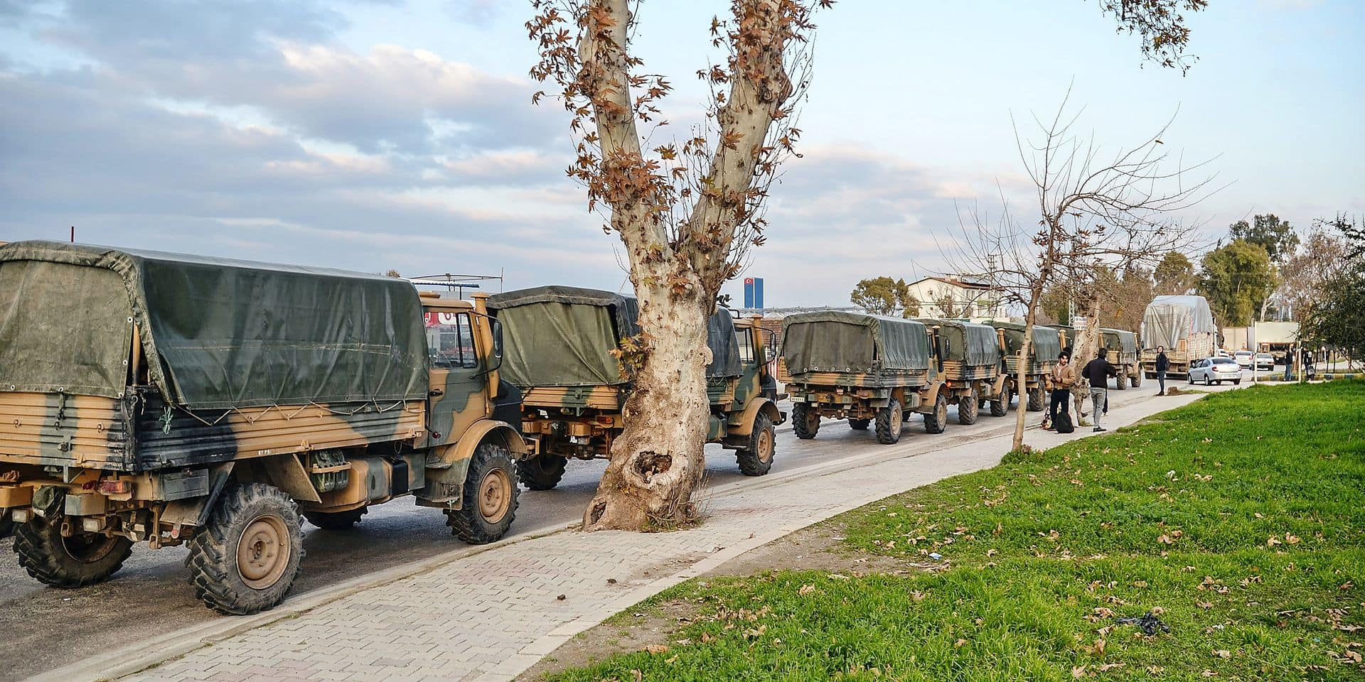 """A picture shows a Turkish military convoy at Kirikhan, in Hatay region at the Syria border, on January 12, 2019. - Turkey vowed on January 14, 2019 to continue fighting a US-backed Kurdish militia which it views as a terrorist group after US President Donald Trump warned of economic devastation if Ankara attacks Kurdish forces as American troops withdraw. Turkish President Recep Tayyip Erdogan's spokesman Ibrahim Kalin said on Twitter that there was """"no difference"""" between the Islamic State extremist group and the Kurdish People's Protection Units (YPG) militia. (Photo by STRINGER / DHA / AFP) / Turkey OUT"""