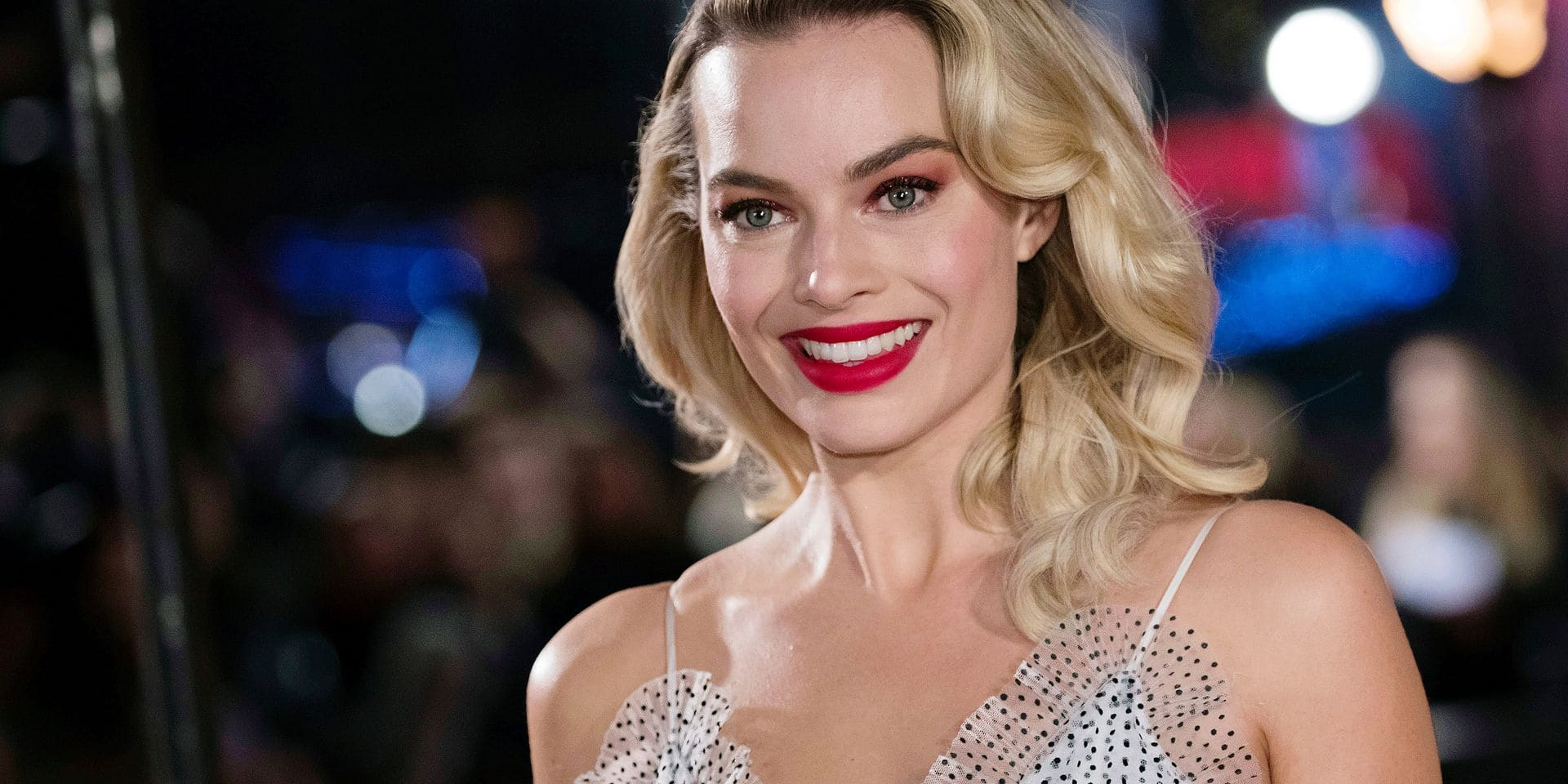 "FILE - In this Monday, Dec. 10, 2018, file photo, actress Margot Robbie poses for photographers upon her arrival at the premiere of the film ""Mary Queen of Scots,"" in London. Robbie will bring the Barbie doll to life in a live-action film. Mattel and Warner Bros. Pictures announced Tuesday, Jan. 8, 2019, that Robbie will star as the iconic doll in the franchise's first-ever live-action film. The 28-year-old ""Suicide Squad"" actress will also co-produce the film under her LuckyChap Entertainment banner. (Photo by Vianney Le Caer/Invision/AP, File)"