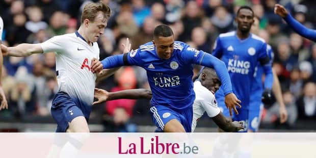 Leicester City's Youri Tielemans, center, fights for the ball with Tottenham Hotspur's Davinson Sanchez, right and Tottenham Hotspur's Oliver Skipp, left, during the English Premier League soccer match between Tottenham Hotspur and Leicester City at Wembley stadium in London, Sunday, Feb. 10, 2019. (AP Photo/Matt Dunham)