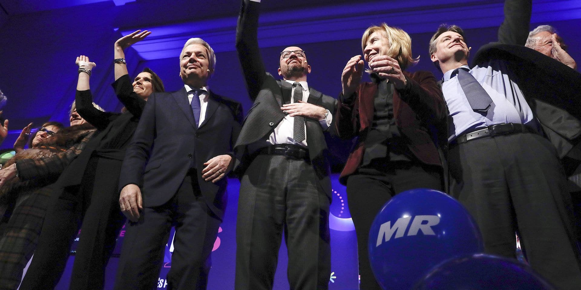 Minister of Budget Sophie Wilmes, Vice-Prime Minister and Foreign Minister Didier Reynders, Belgian Prime Minister Charles Michel, MR's Francoise Schepmans and MR chairman Olivier Chastel pictured during the new year's reception of the Brussels' branch of French-speaking liberal party MR, Thursday 18 January 2018. BELGA PHOTO THIERRY ROGE