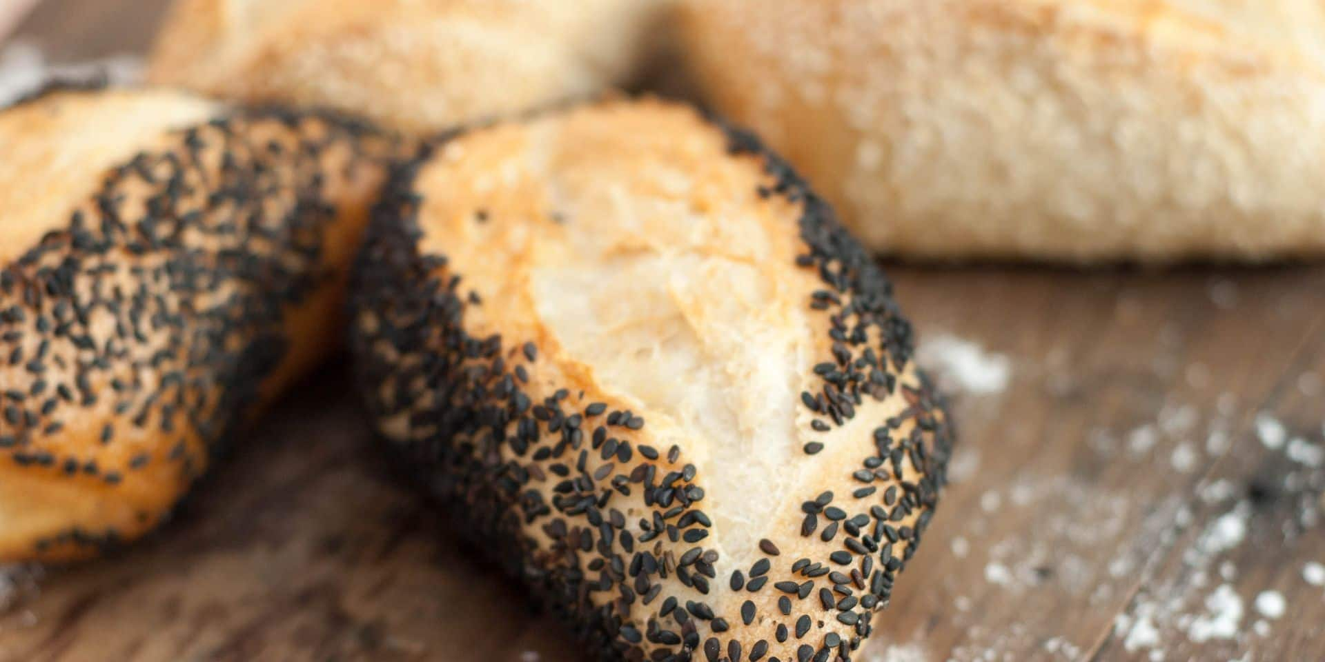 Bread,With,Sesame,On,A,Board.