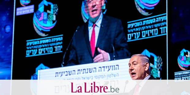 """Israeli Prime Minister Benjamin Netanyahu speaks during the Muni World conference in Tel Aviv on February 14, 2018. Netanyahu said today his government was """"stable"""" and criticised the police investigation against him after detectives recommended his indictment for corruption, prompting calls for him to resign. / AFP PHOTO / JACK GUEZ"""