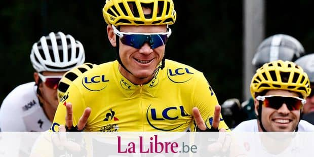 (FILES) This file photo taken on July 23, 2017 shows Great Britain's Christopher Froome (C) wearing the overall leader's yellow jersey flashing victory sign next to Spain's Mikel Landa during the 103 km twenty-first and last stage of the 104th edition of the Tour de France cycling race between Montgeron and Paris Champs-Elysees. Chris Froome's Tour de France 2018 participation thrown into doubt after Tour's owners 'block him from competing' on July 1, 2018. / AFP PHOTO / Jeff PACHOUD