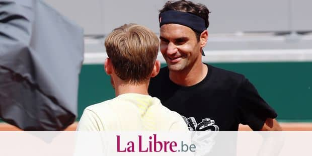 Swiss Roger Federer and Belgian David Goffin shake hands at the end of a training session ahead of the Roland Garros French Open tennis tournament, in Paris, France, Wednesday 22 May 2019. The main draw of this year's Roland Garros Grand Slam takes place from 26 May to 9 June. BELGA PHOTO VIRGINIE LEFOUR