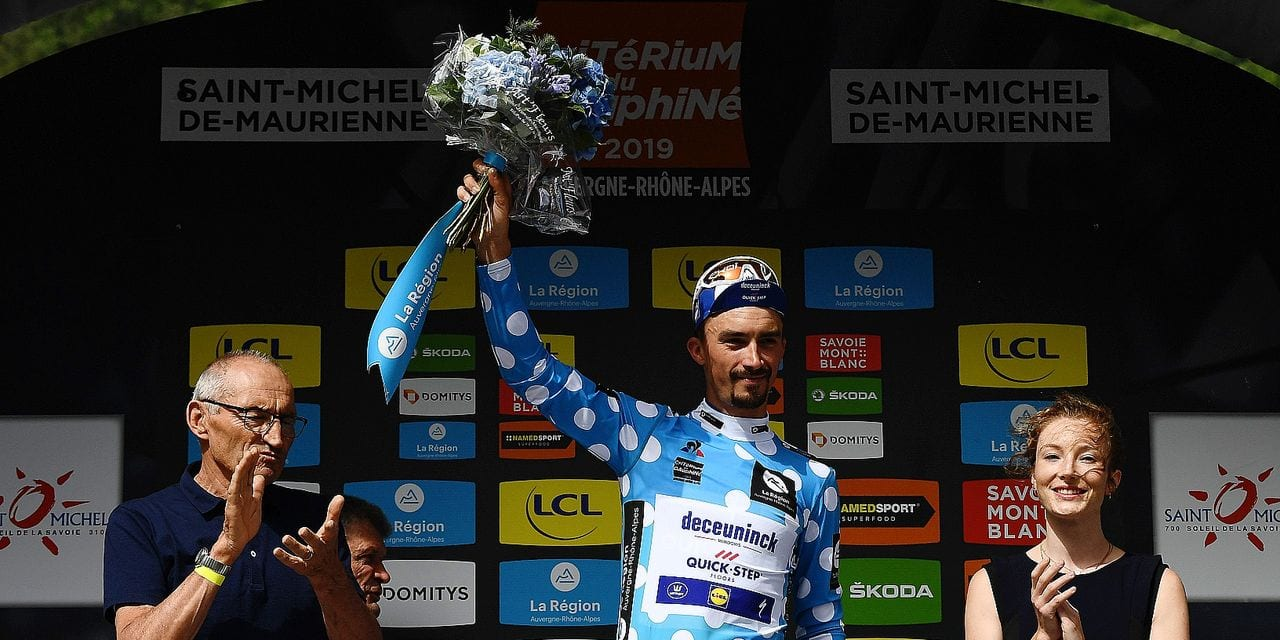 Team Deceuninck-Quick-Step rider France's Julian Alaphilippe (C) celebrates his best climber's polka dot jersey on the podium of the sixth stage of the 71st edition of the Criterium du Dauphine cycling race, 229 km between Saint-Vulbas Plaine de l'Ain and Saint-Michel-de-Maurienne on June 14, 2019. (Photo by Anne-Christine POUJOULAT / AFP)