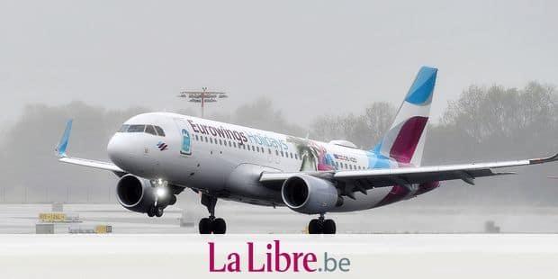 OE-IQD - Airbus A320-214 - Eurowings, landing in the rain, spray. Air traffic, fliegen.Luftfahrt. Franz Josef Strauss Airport in Munich.Munich. | usage worldwide Reporters / DPA