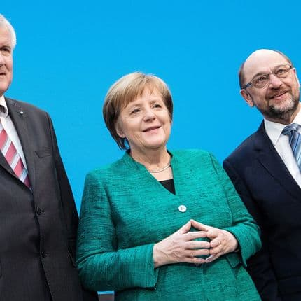 Horst Seehofer, Chairman of the Christian Social Union (CSU) (L-R), German Chancellor Angela Merkel, of the Christian Democratic Union (CDU) and the chairman of the Social Democratic Party (SPD), Martin Schulz, pose for a picture during a press conference after the CDU, CSU and SPD sealed a deal on a new coalition government at the Konrad-Adenauer-Haus, in Berlin, Germany, 07 February 2018. Photo: Bernd von Jutrczenka/dpa