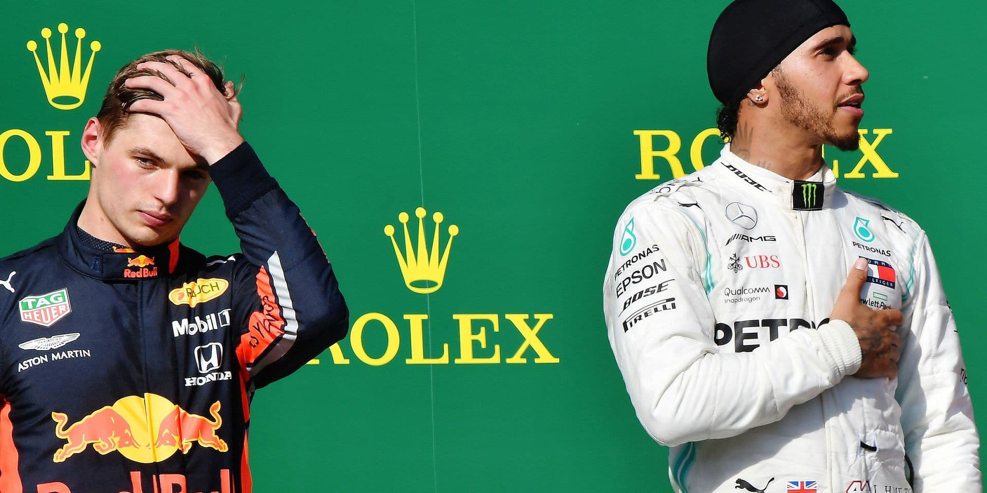 Red Bull's Dutch driver Max Verstappen (L) and Mercedes' British driver Lewis Hamilton stand on the podium after the Formula One Hungarian Grand Prix at the Hungaroring circuit in Mogyorod near Budapest, Hungary, on August 4, 2019. (Photo by Attila KISBENEDEK / AFP)