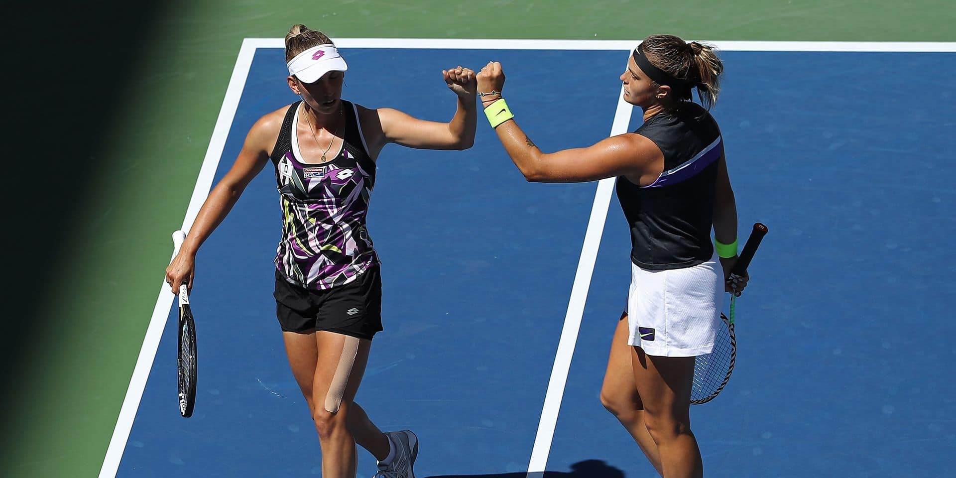 NEW YORK, NEW YORK - SEPTEMBER 03: Elise Mertens of Belgium (L) celebrates the point with Aryna Sabalenka of Belarus during their Women's Doubles quarterfinal match against Saisai Zheng and Yingying Duan of China on day nine of the 2019 US Open at the USTA Billie Jean King National Tennis Center on September 03, 2019 in the Queens borough of New York City. Elsa/Getty Images/AFP == FOR NEWSPAPERS, INTERNET, TELCOS & TELEVISION USE ONLY ==