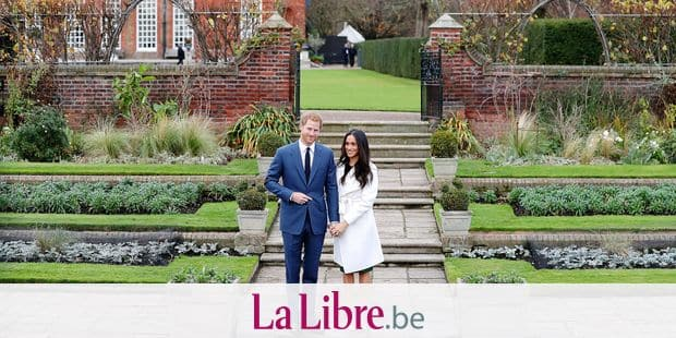 Britain's Prince Harry and his fiancée US actress Meghan Markle pose for a photograph in the Sunken Garden at Kensington Palace in west London on November 27, 2017, following the announcement of their engagement. Britain's Prince Harry will marry his US actress girlfriend Meghan Markle early next year after the couple became engaged earlier this month, Clarence House announced on Monday. / AFP PHOTO / Daniel LEAL-OLIVAS