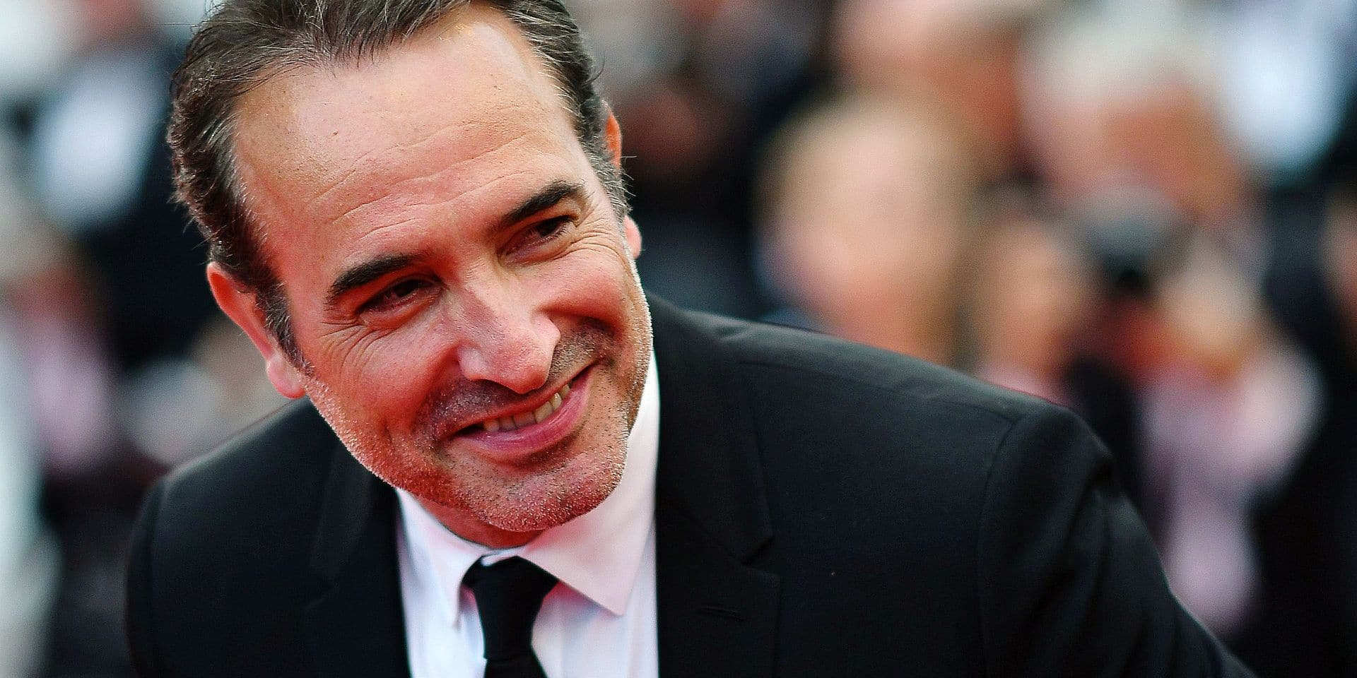 "(FILES) In this file photo taken on May 20, 2019 French actor Jean Dujardin arrives for the screening of the film ""La Belle Epoque"" at the 72nd edition of the Cannes Film Festival in Cannes, southern France. - Jean Dujardin is playing in the film called ""Le Daim"" that will be showing in the French cinemas from June 19, 2019. (Photo by Alberto PIZZOLI / AFP)"