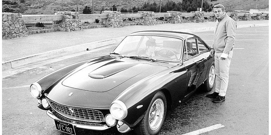 In an undated photo provided by Christie's Images Ltd., actor Steve McQueen stands next to his 1963 Ferrari 250 GT Berlinetta Lusso. The car sold for $2.31 million Thursday night, Aug. 16, 2007, at auction in Monterey, Calif. An anonymous car collector who placed a bid by phone bought the vehicle, said Christie's spokesman Rik Pike. (AP Photo/William Claxton, Courtesy of Demont Photo Management LLC) ** FOR USE ONLY WITH STORIES ON SALE OF THE VEHICLE NO SALES **