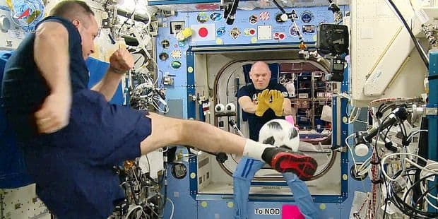 5516387 31.05.2018 In this framegrab made from a footage released by Roscosmos on Thursday, May 31, 2018 Russian cosmonauts Anton Shkaplerov, left, and Oleg Artemyev play with a ball onboard International Space Station. This ball is a copy of the World Cup offical ball and will be brought back to Earth on June 3. The World Cup 2018 will start on June 14 and take place in 11 cities across Russia. The image is a handout courtesy of a third party. Editorial use only. No archiving, no sales, no commercial use. Roscosmos