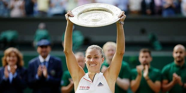 Germany's Angelique Kerber lifts the trophy after winning the women's singles final match against Serena Williams of the United States, at the Wimbledon Tennis Championships, in London, Saturday July 14, 2018.(AP Photo/Tim Ireland)