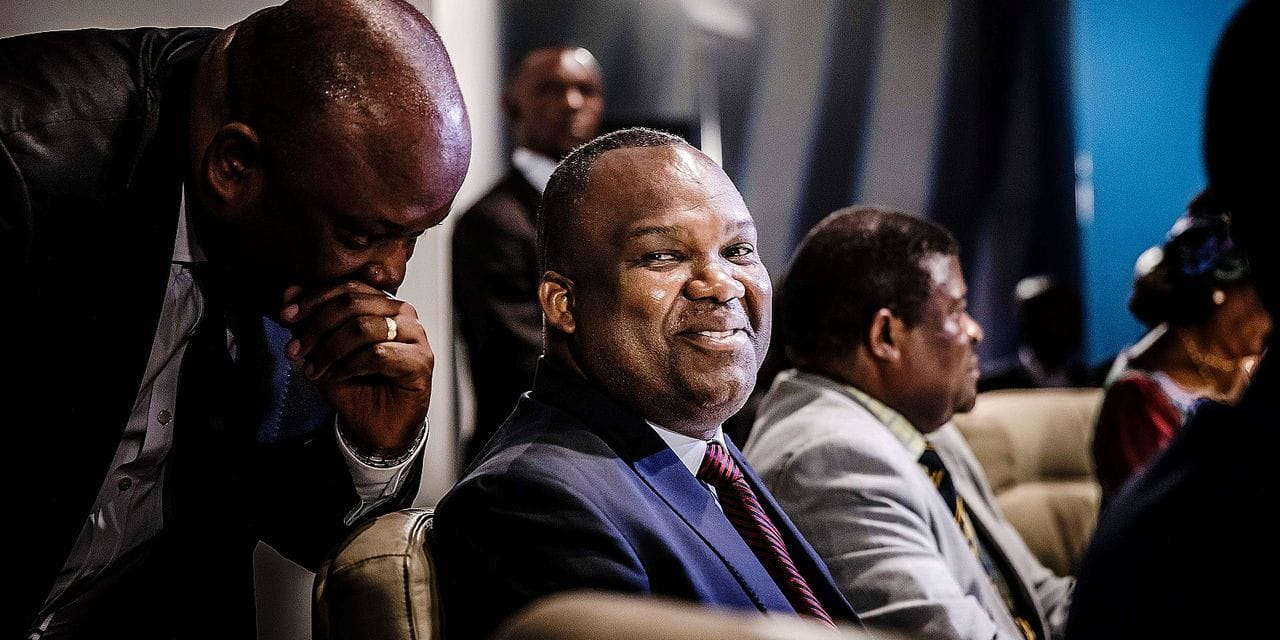 DRC's Electoral Commission President Corneille Nangaa Yobeluo reacts during a meeting with DRC's Prime Mimister about a possible postponement of the vote, at the National Assembly, in Kinshasa, Democratic Republic of Congo (DRC) on December 20, 2018 just few days ahead of the elections day. - Democratic Republic of Congo's electoral commission CENI called for a meeting at the National Assembly with electoral candidates ahead of possible postponement of the ballot of December 23, 2018. Prime Minister Bruno Thsibala was also present, but main opposition candidates Felix Thsisekedi, Martin Fayulu and Emmanuel Shadary didn't attend the meeting. (Photo by Luis TATO / AFP)