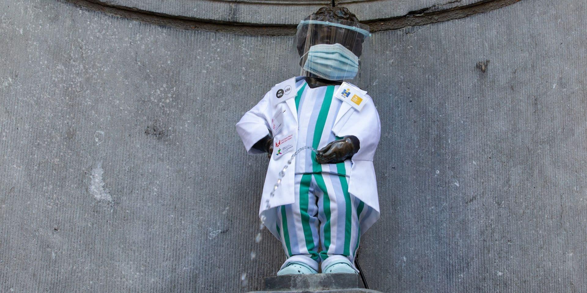 """Manneken-Pis porte une tenue de soignant en l'honneur des 'héros' du réseau Iris: """"Je tiens par ce geste à remercier l'ensemble de ces travailleuses et travailleurs de première ligne"""""""