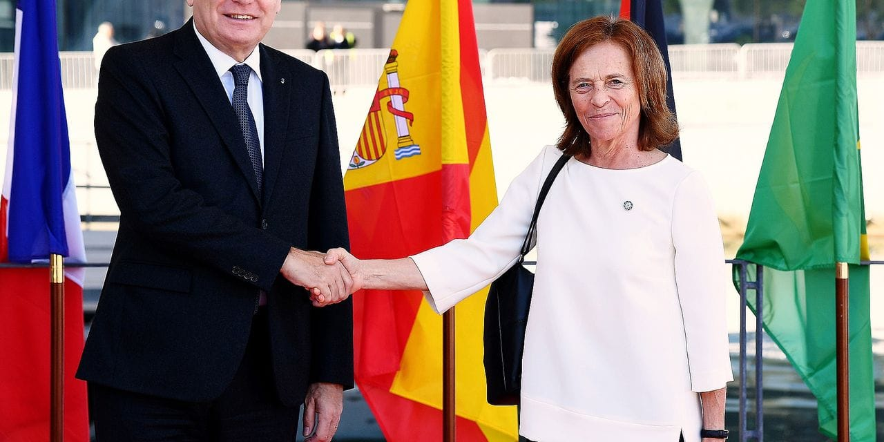 French Foreign Minister Jean-Marc Ayrault (L) shakes hands with Portuguese Secretary of State for European Affairs Margarida Marques (R) upon her arrival at the Villa Mediterranée in Marseille, southern France, on October 28, 2016, for the 13th meeting of the Foreign Affairs Ministers of the Western Mediterranean (5+5 Dialogue). / AFP PHOTO / ANNE-CHRISTINE POUJOULAT