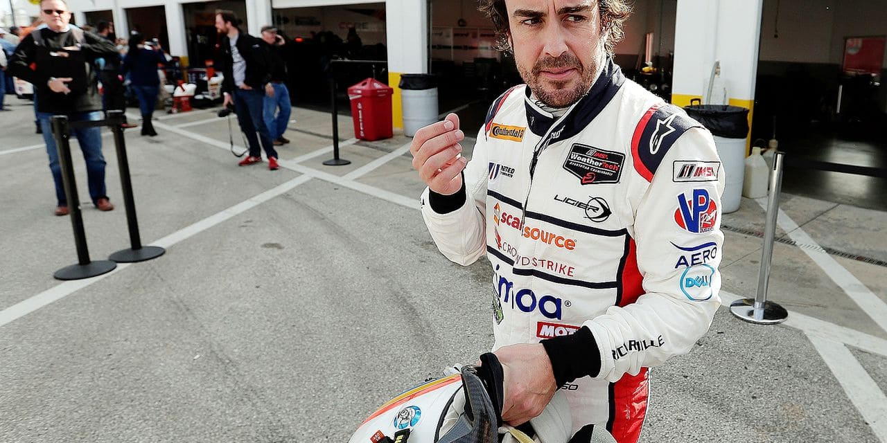 Fernando Alonso, of Spain, leaves his garage after a practice session for the IMSA 24-hour auto race at Daytona International Speedway, Friday, Jan. 26, 2018, in Daytona Beach, Fla. (AP Photo/John Raoux)