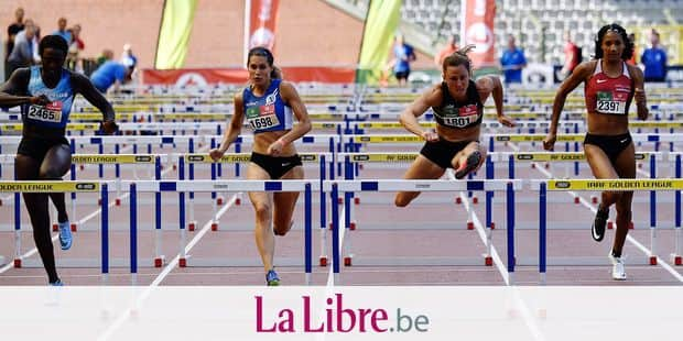 Belgian Anne Zagre, Belgian Eline Berings and Belgian Nafissatou Nafi Thiam pictured in action during the women's 100m hurdles at the Belgian Athletics championships, Sunday 08 July 2018 in Brussels. BELGA PHOTO ERIC LALMAND