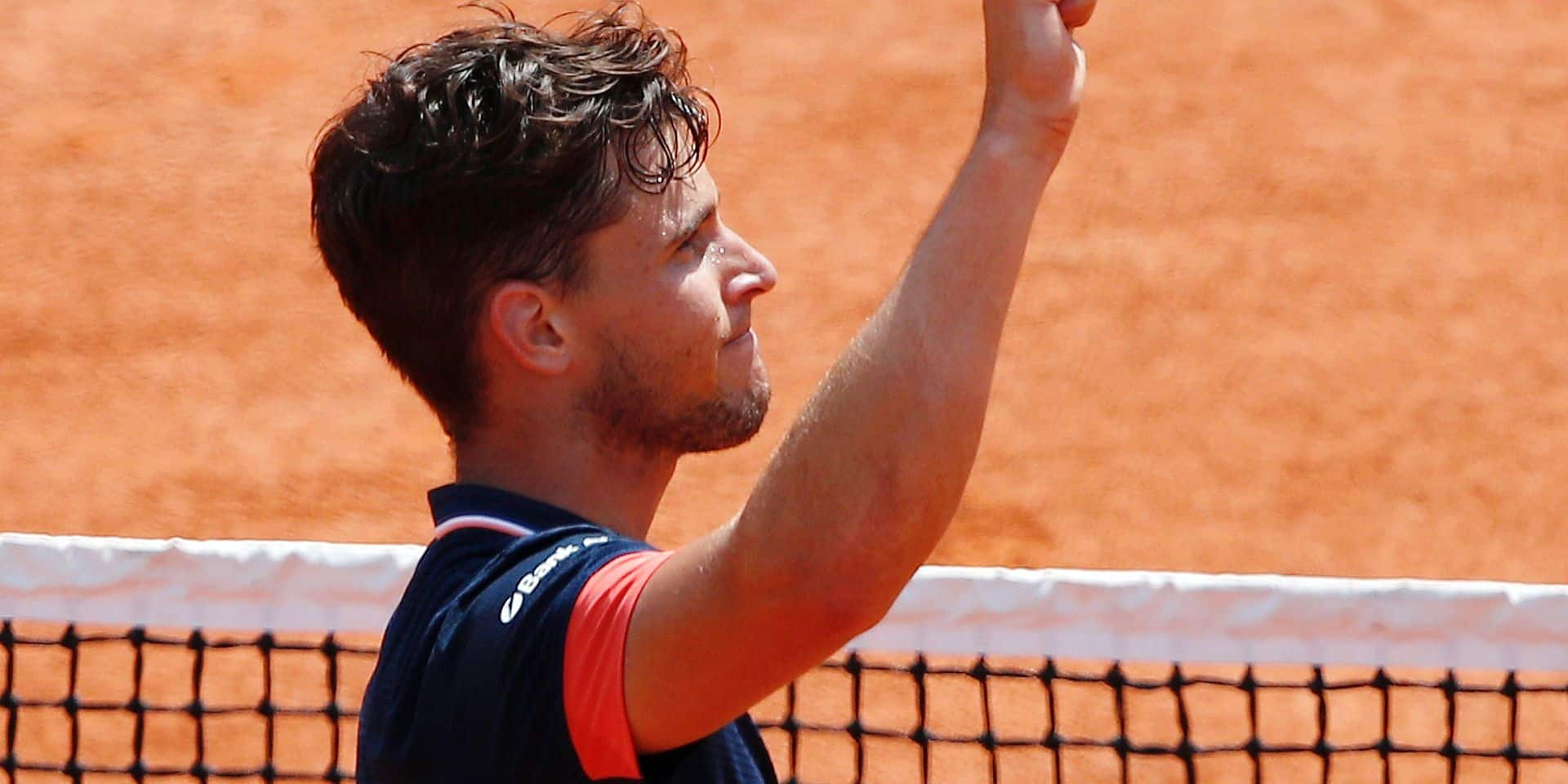 Austria's Dominic Thiem celebrates winning his semifinal match of the French Open tennis tournament against Italy's Marco Cecchinato in three sets 7-5, 7-6 (12-10), 6-1, at the Roland Garros stadium in Paris, France, Friday, June 8, 2018. (AP Photo/Christophe Ena)