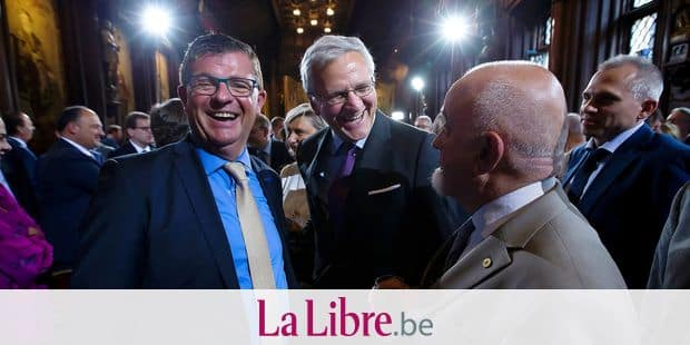 Flemish Minister of Finance, Budget and Energy Bart Tommelein, Vice-Prime Minister and Minister of Employment, Economy and Consumer Affairs Kris Peeters and Flemish parliament chairman Jan Peumans pictured after a reception at the Brussels' City Hall, part of the celebrations on the occasion of the Flemish regional holiday, Wednesday 11 July 2018. BELGA PHOTO KRISTOF VAN ACCOM