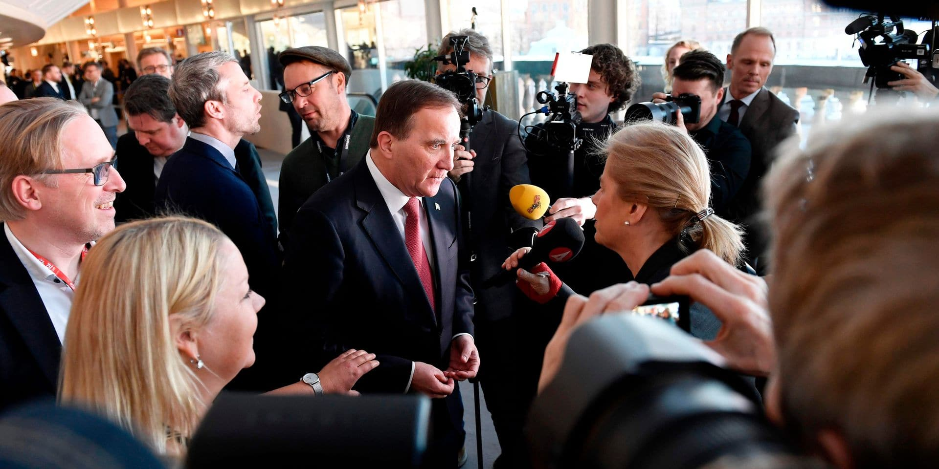 Social Democrat leader Stefan Lofven (C) gives an interview after being elected for a second term as prime minister on January 18, 2019 at the Swedish Parliament Riksdagen in Stockholm. - Sweden ended a four-month political vacuum when lawmakers elected Prime Minister Stefan Lofven to a second term, after he elbowed out the far-right to save one of Europe's few left-wing governments. Lofven's new minority centre-left government -- comprising his Social Democrats and the Greens -- won the backing of the Centre and Liberal parties, until now members of the four-party centre-right opposition Alliance. (Photo by Stina STJERNKVIST / TT News Agency / AFP) / Sweden OUT