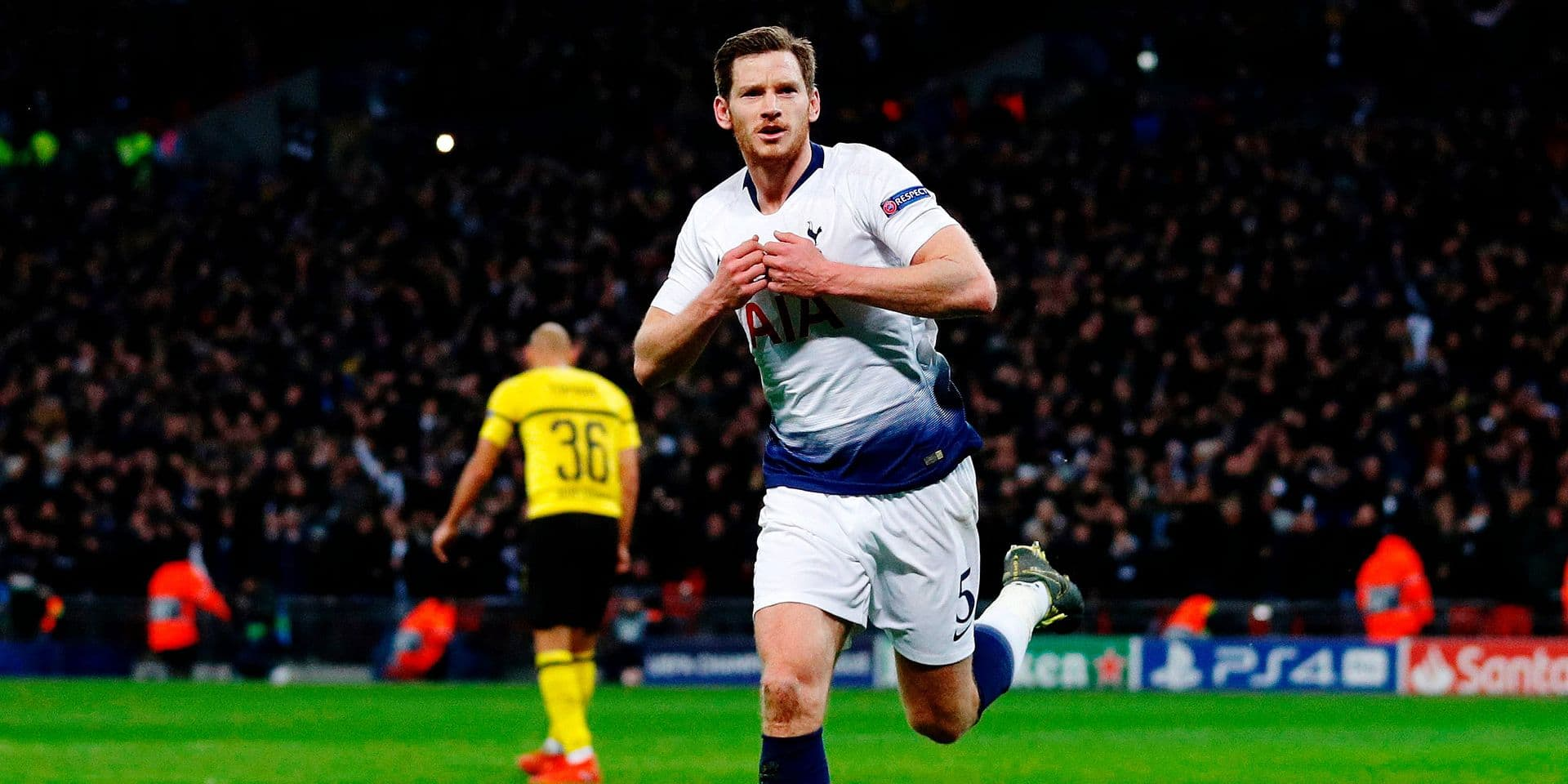 Tottenham Hotspur's Belgian defender Jan Vertonghen celebrates after scoring their second goal during the UEFA Champions League round of 16 first leg football match between Tottenham Hotspur and Borussia Dortmund at Wembley Stadium in London on February 13, 2019. (Photo by Adrian DENNIS / AFP)