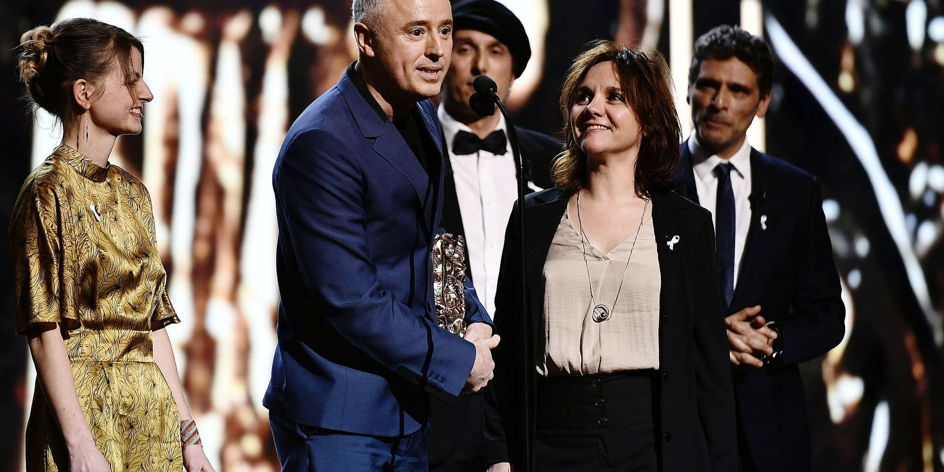 """French screenwriter and film director Robin Campillo (C) delivers a speech after winning the Best Editing award for the film """"120 battements par minute"""" (BPM-Beats Per Minute) during the 43rd edition of the Cesar Awards ceremony at the Salle Pleyel in Paris on March 2, 2018. / AFP PHOTO / Philippe LOPEZ"""